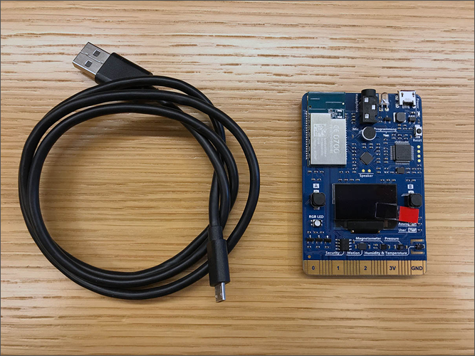 A Micro USB cable placed next to an Azure MXChip IoT DevKit IoT Development Board