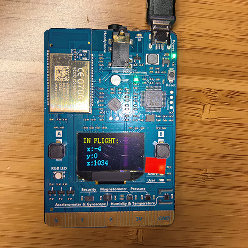 "The MXChip IoT DevKit display shows a label of ""In Flight"" with telemetry data for x, y and z axis readings from the onboard gyroscope."